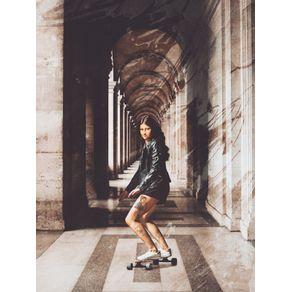 MONALISA RIDING ON HER LONGBOARD